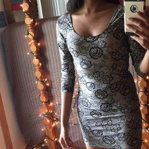Black lace print on nude, sleeve dress